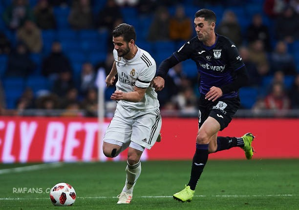 nacho-fernandez-of-real-madrid-competes-for-the-ball-with-sabin-of-picture-id109.jpg